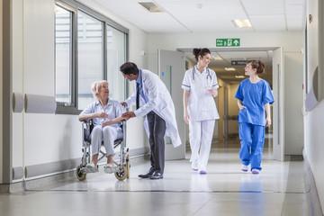 Senior Female Patient in Wheelchair & Doctor in Hospital