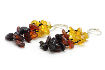 Multicolor Baltic amber earrings isolated