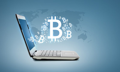 laptop computer with bitcoin