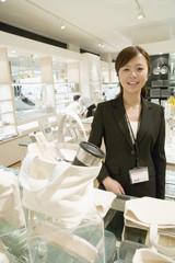 female salesclerk of tableware department