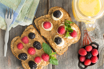 Peanut butter sandwiches with berries and cheese