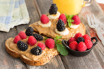 Peanut butter sandwiches topped with fresh berries