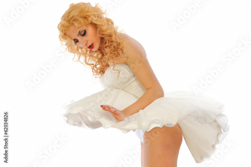 Pretty pin-up girl in white surprise
