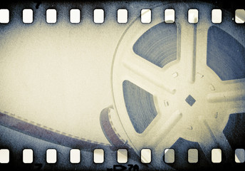 Old motion picture reel with film strip.