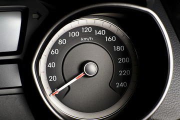 Fragment of instrument panel of car speedometer, tachometer with
