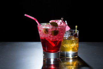 Strawberry cocktail and whiskey liqueur glass