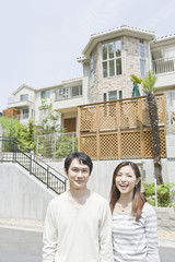 couple smiling in residential street