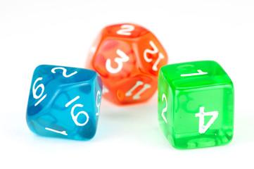 Three colorful translucent dice, on white
