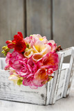 Bouquet of colorful freesia flowers in wooden shabby chic box