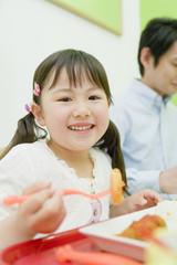 smiling girl having meal