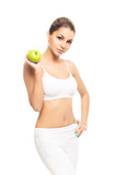 A fit and beautiful girl with an apple isolated on white