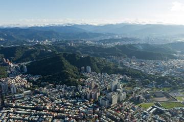 Bird's eye view of Taipei between hills in daylight