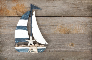 Toy sailboat on a wooden background