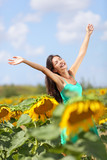 Summer girl happy in sunflower flower field