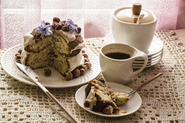 White chocolate cake with hazelnuts and cream