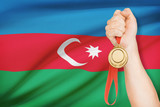 Medal in hand with flag on background - Republic of Azerbaijan