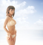 A girl in nice lingerie on a sky and sea background