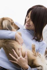 Miniature dachshund and woman