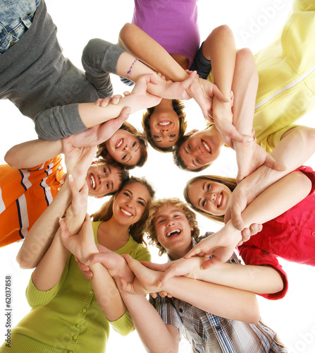 A group of smiling happy teenagers isolated on white