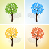 Four colored trees on a light background