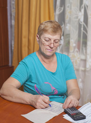 senior lady writing counts at home