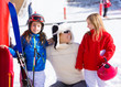 snow winter family in ski track mother and daughters