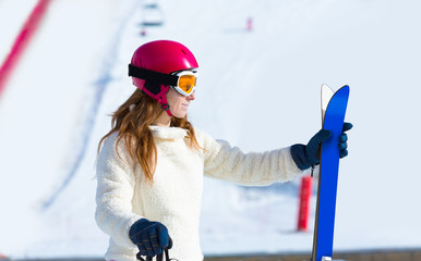 ski woman in winter snow with equipment