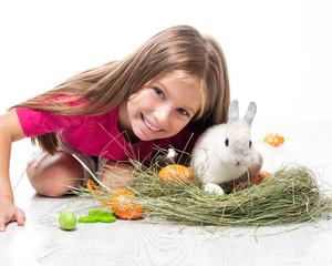 happy little girl and rabbit
