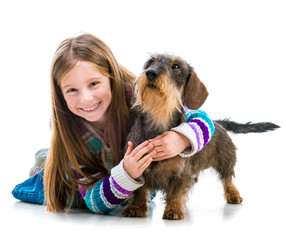 happy little girl with her dachshund
