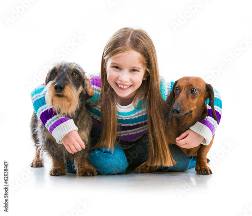 happy little girl with her dachshunds