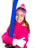Kid girl ski with snow equipment goggles and winter hat