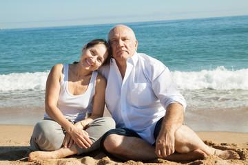 mature couple together at sea beach