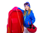 Blond kid girl with red sled snow equipment helmet and goggles