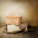 Closeup shot of two wooden boxes wit burlap