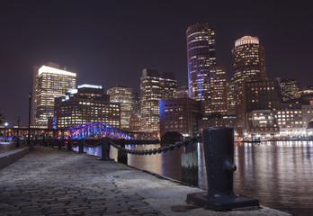 Boston Harbor and Financial District at night in Boston, Massac