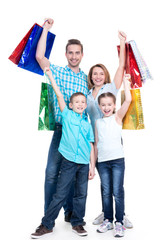 Happy american family with children holding shopping bags