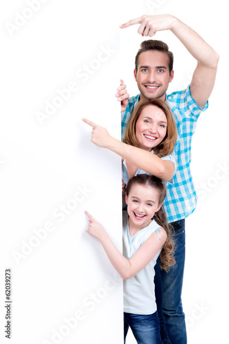 Family pointing by finger to the banner