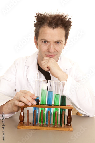 Mad scientist hand on chin test tubes