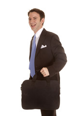 Man suit with bag walk laugh