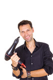 smiling male barber with hair dryer