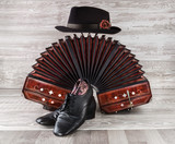 Bandoneon, tango dance shoes and male hat