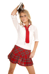 School girl red skirt book hold over head