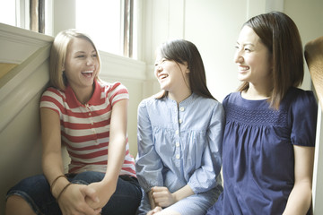 three women talking with smile