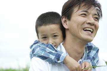 boy hagging father