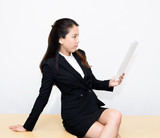 Thai business woman reading a document