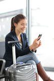 Airport woman on smart phone at gate - air travel