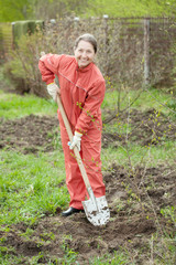 Mature woman working with shovel