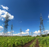 electric masts and road in green field