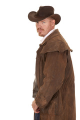 Cowboy leather duster look back serious