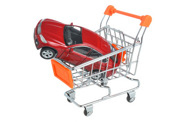 Toy car in shopping cart isolated on white